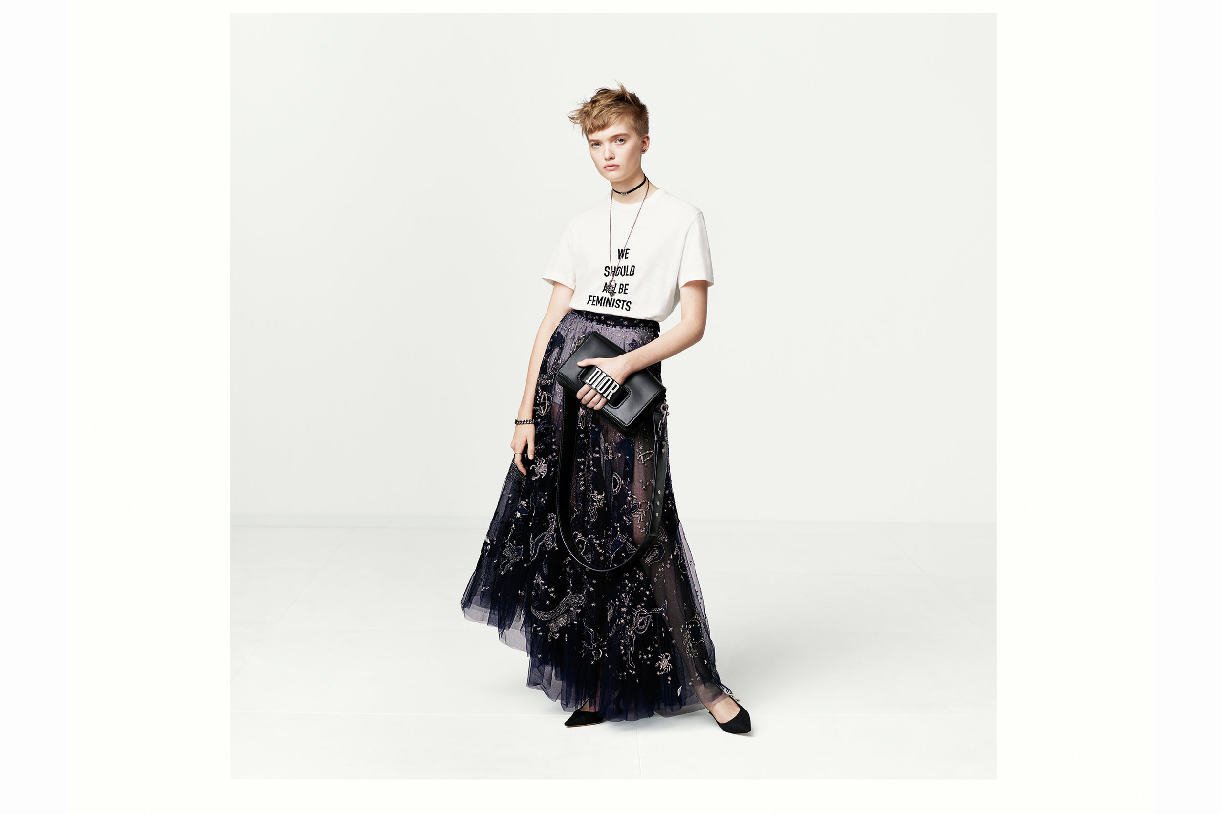 """White cotton and linen """"we should all be feminists"""" print T-shirt by Dior."""