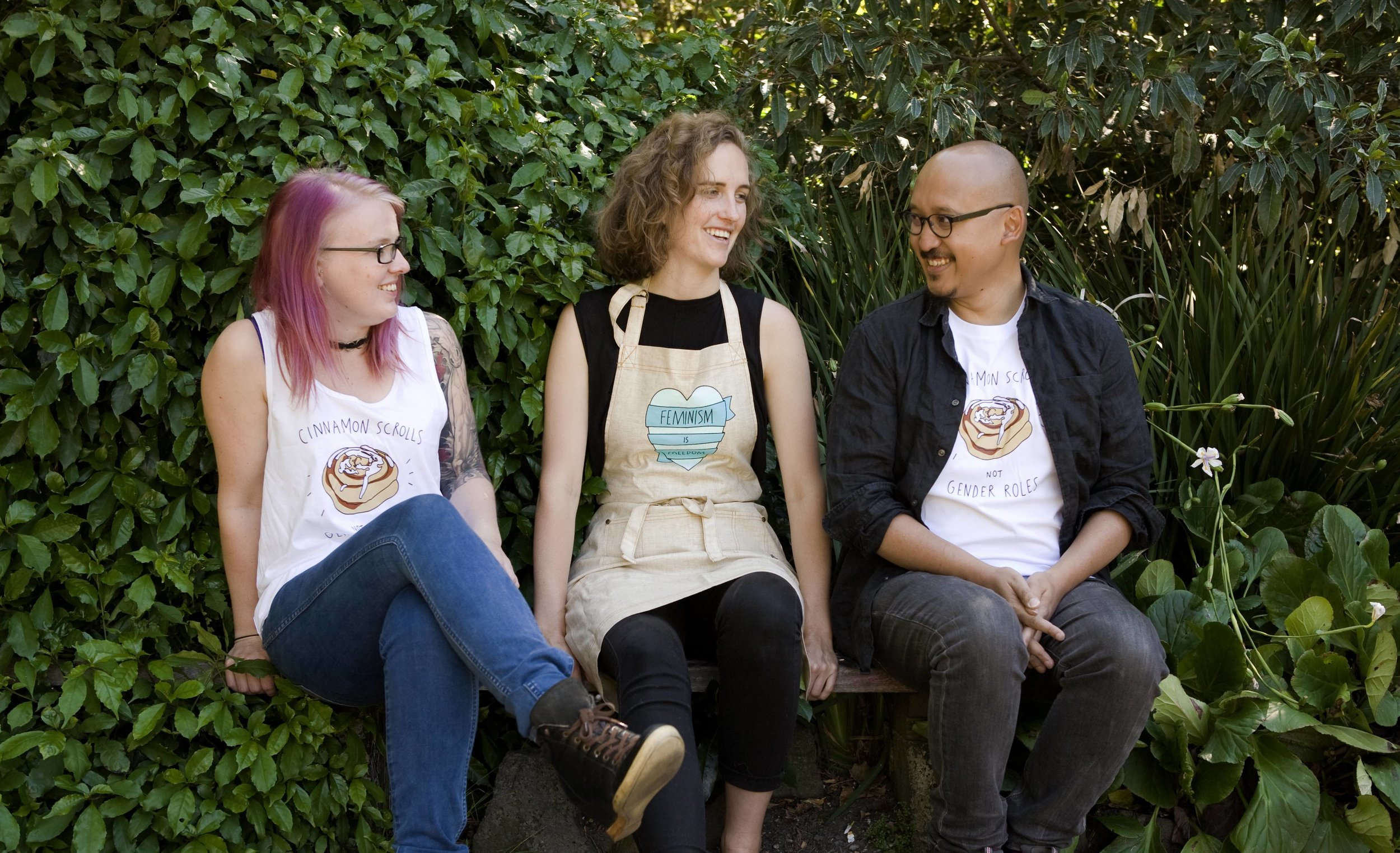 Beth, Riley and Tito wearing our feminist merchandise.