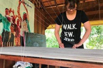 Megan works a loom.
