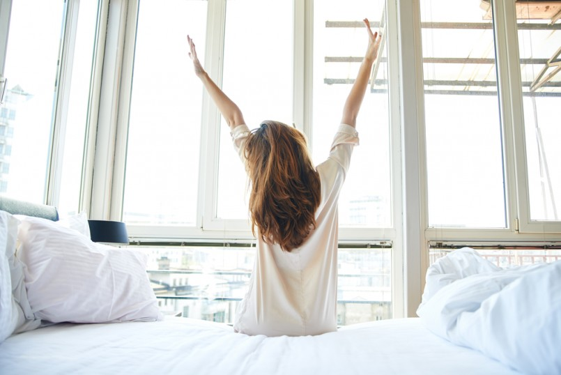 Woman-stretching-in-bed-after-wake-up-back-view-805x538.jpg
