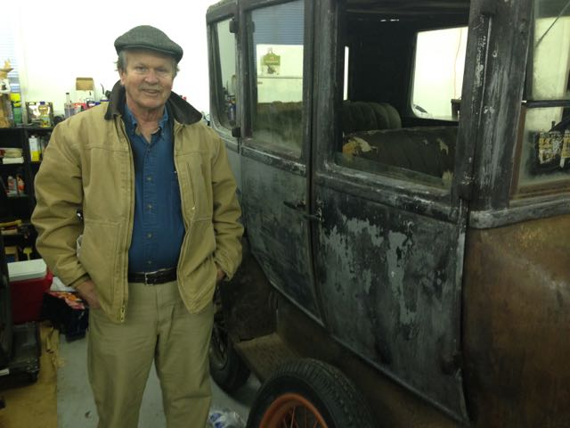 Dave Cooley beside his aluminum bodied Model T Fordor.