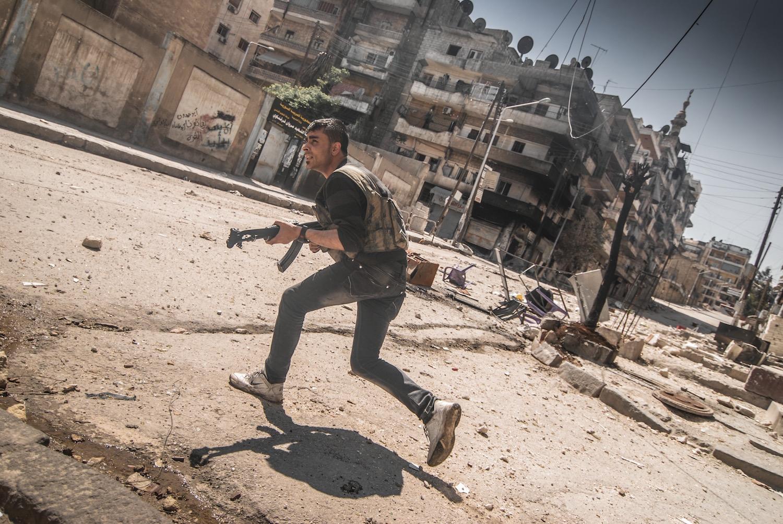 Syria.  Free Syrian Army fighter in Aleppo