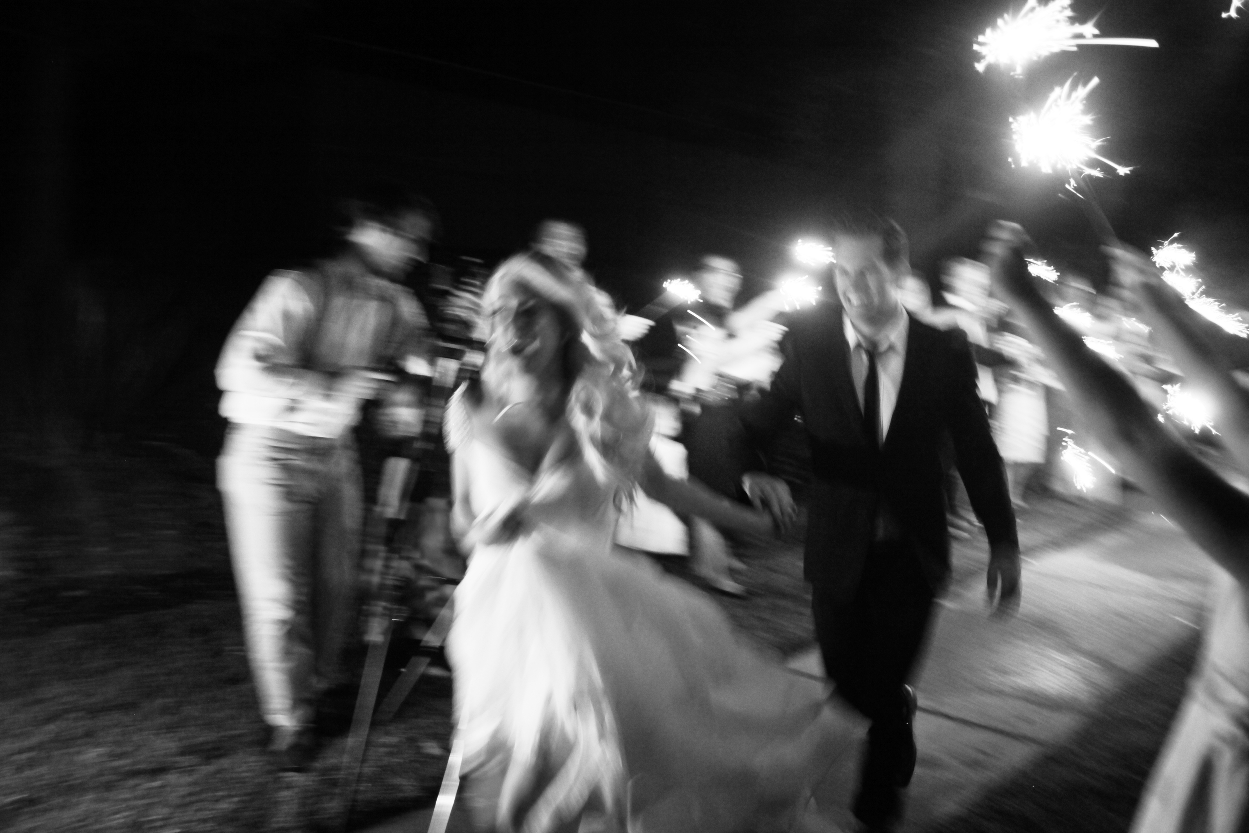 I love this final image especially because it's so blurry. You can just tell they are beyond stoked to be married and to be celebrated -- these are the true real, raw moments.