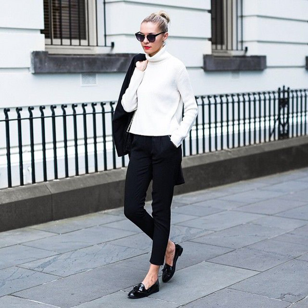 Black trousers and white jumper with black patent loafers