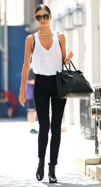 White tank top and black jeans with black pointed toe booties and black bag