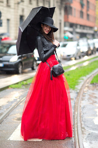 Floor-length red skirt and cropped black leather jacket