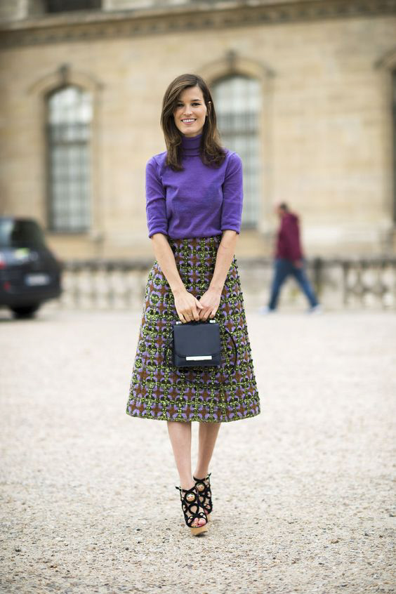 Purple sweater, brocade A-line skirt, box purse and doll shoes