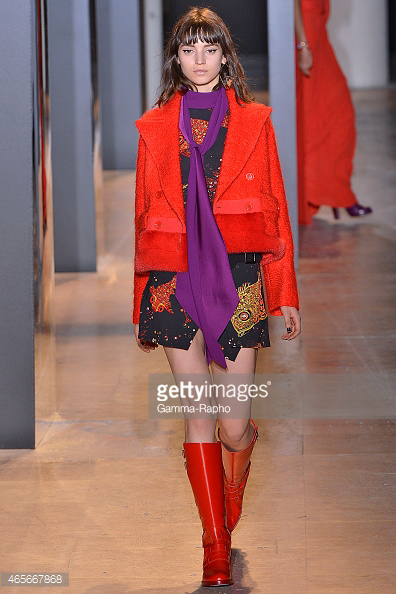 Orange jacket and boots with purple scarf