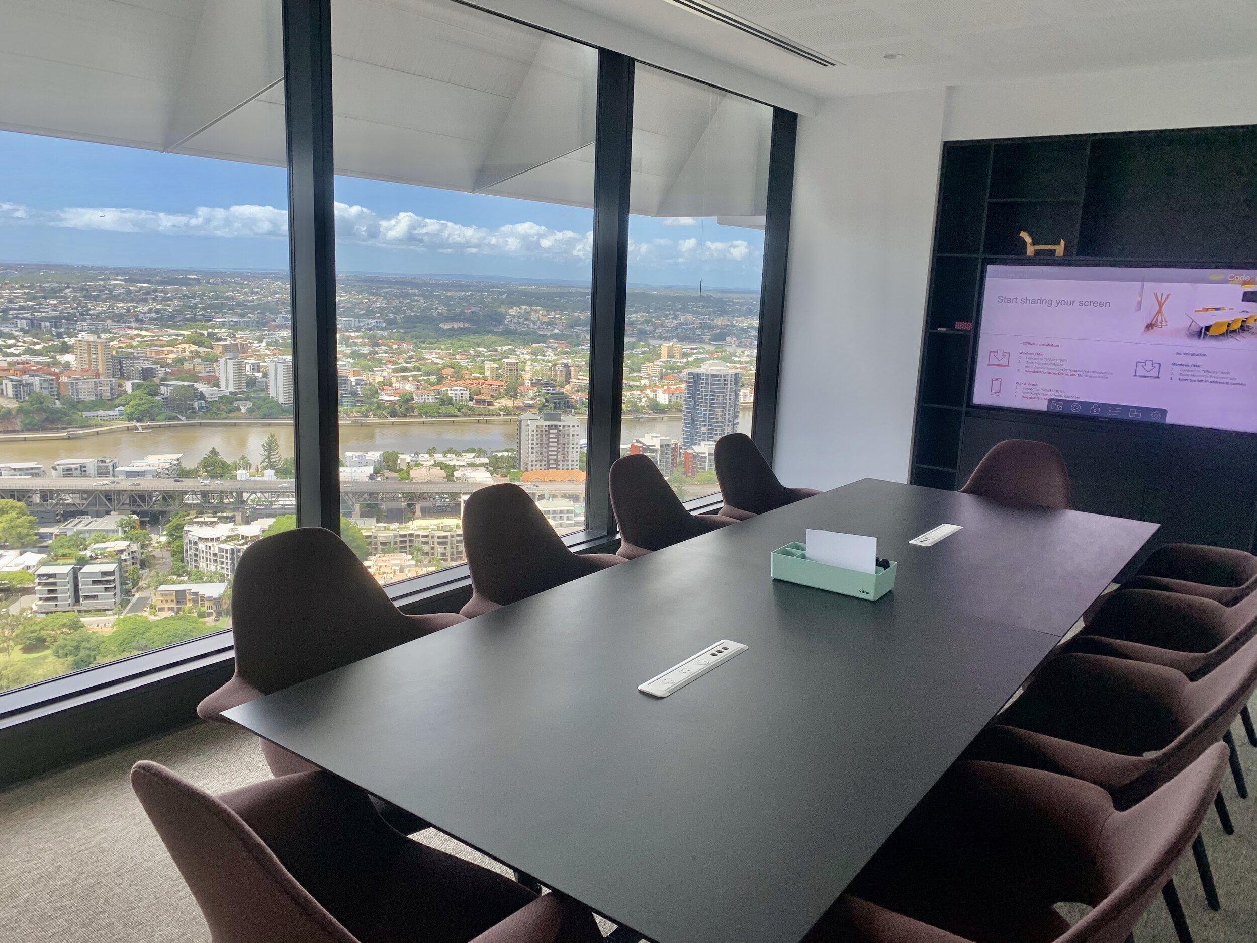 Business meeting overlooking the Brisbane river