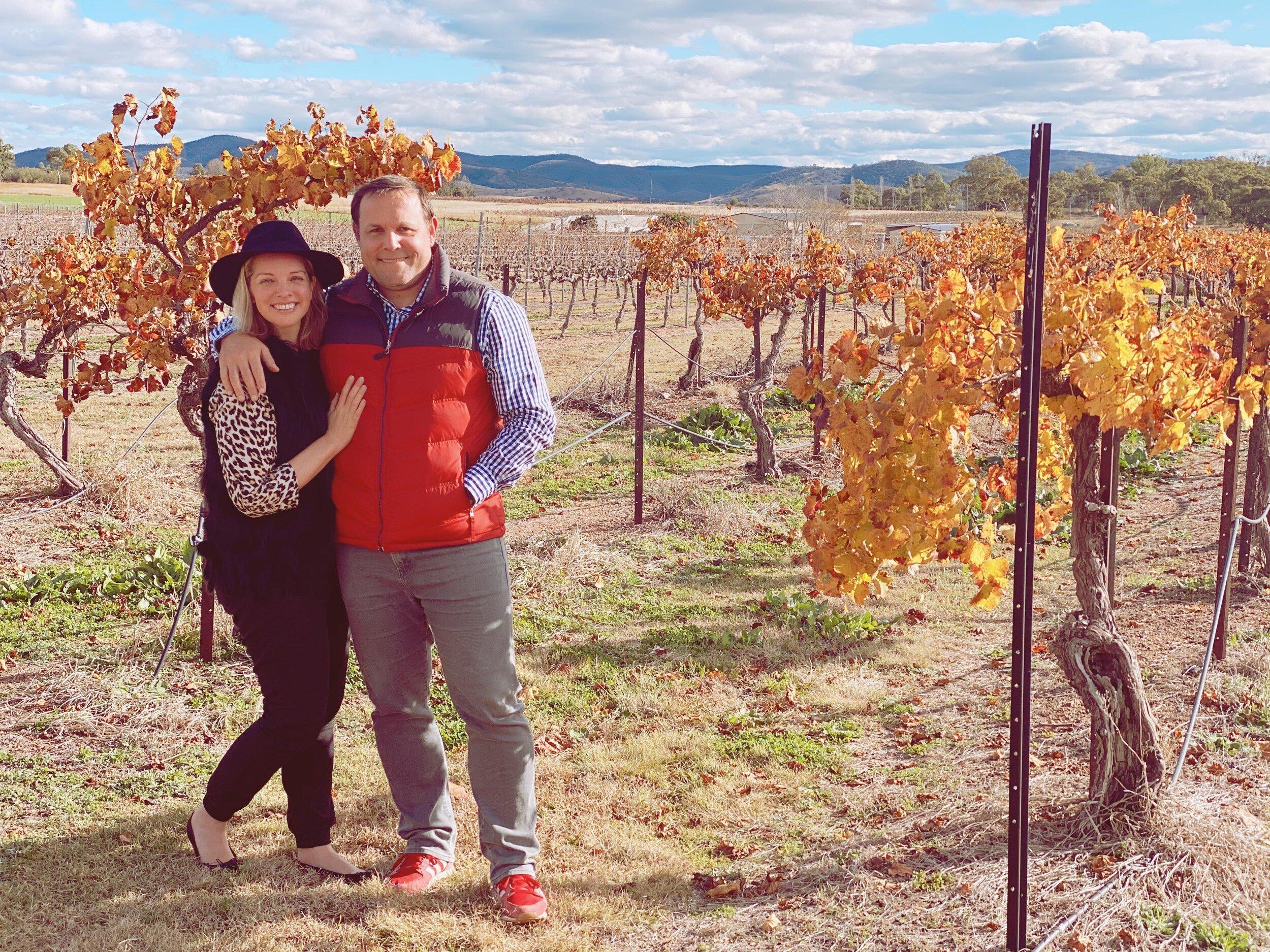 Two people standing in a vinyard