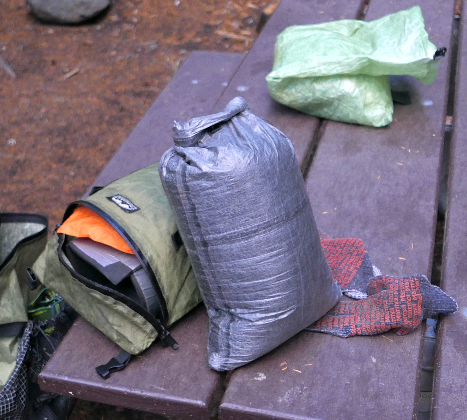stuff sack containing EE 50 degree Enigma quilt, Borah Gear down jacket, EE booties and Hoodlum