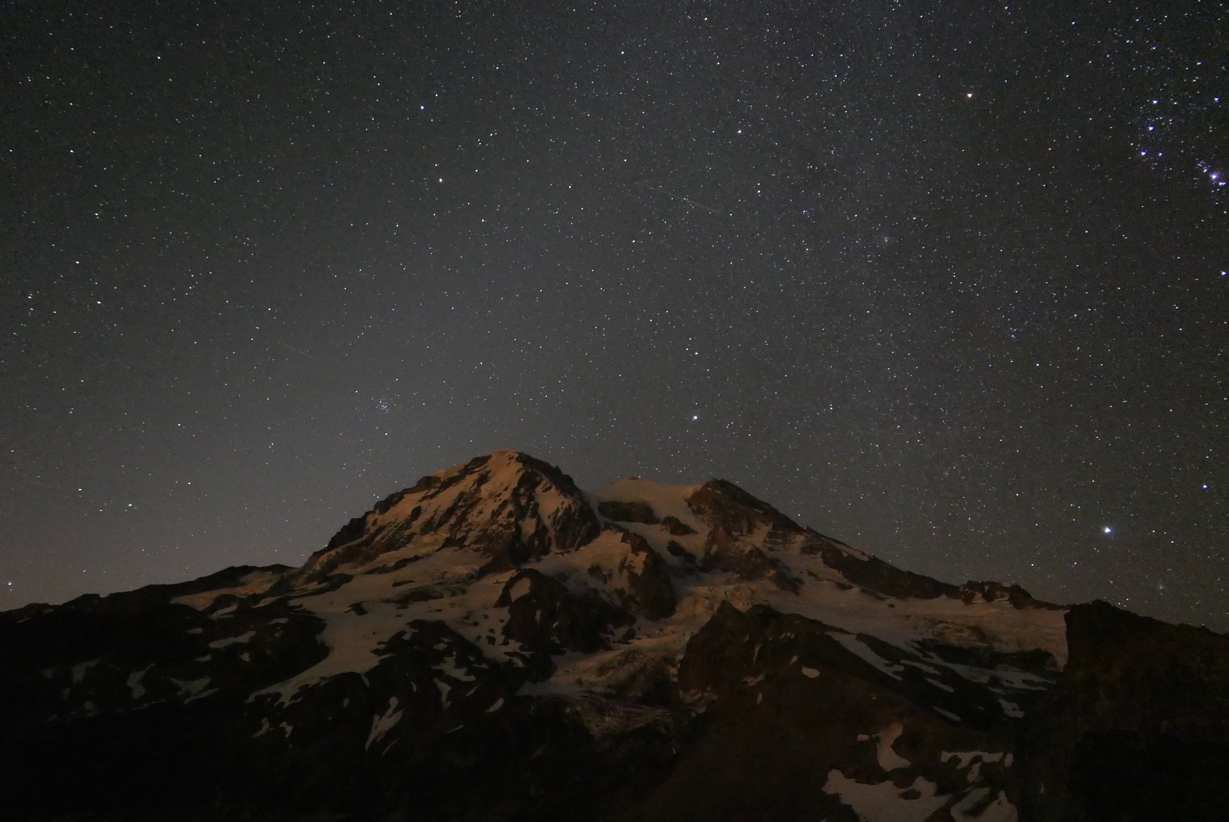Predawn glow behind the mountain as seen from my bivy spot on The Colonnade, Mt. Rainier