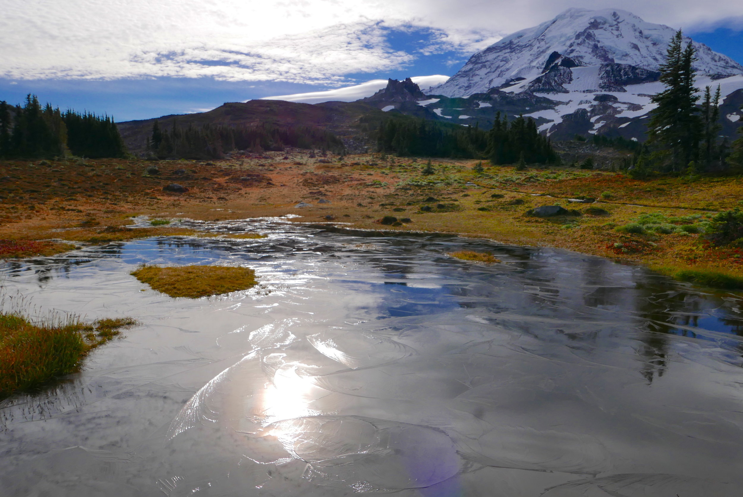 frozen tarn in Spray Park, looking at Echo and Observation Rocks