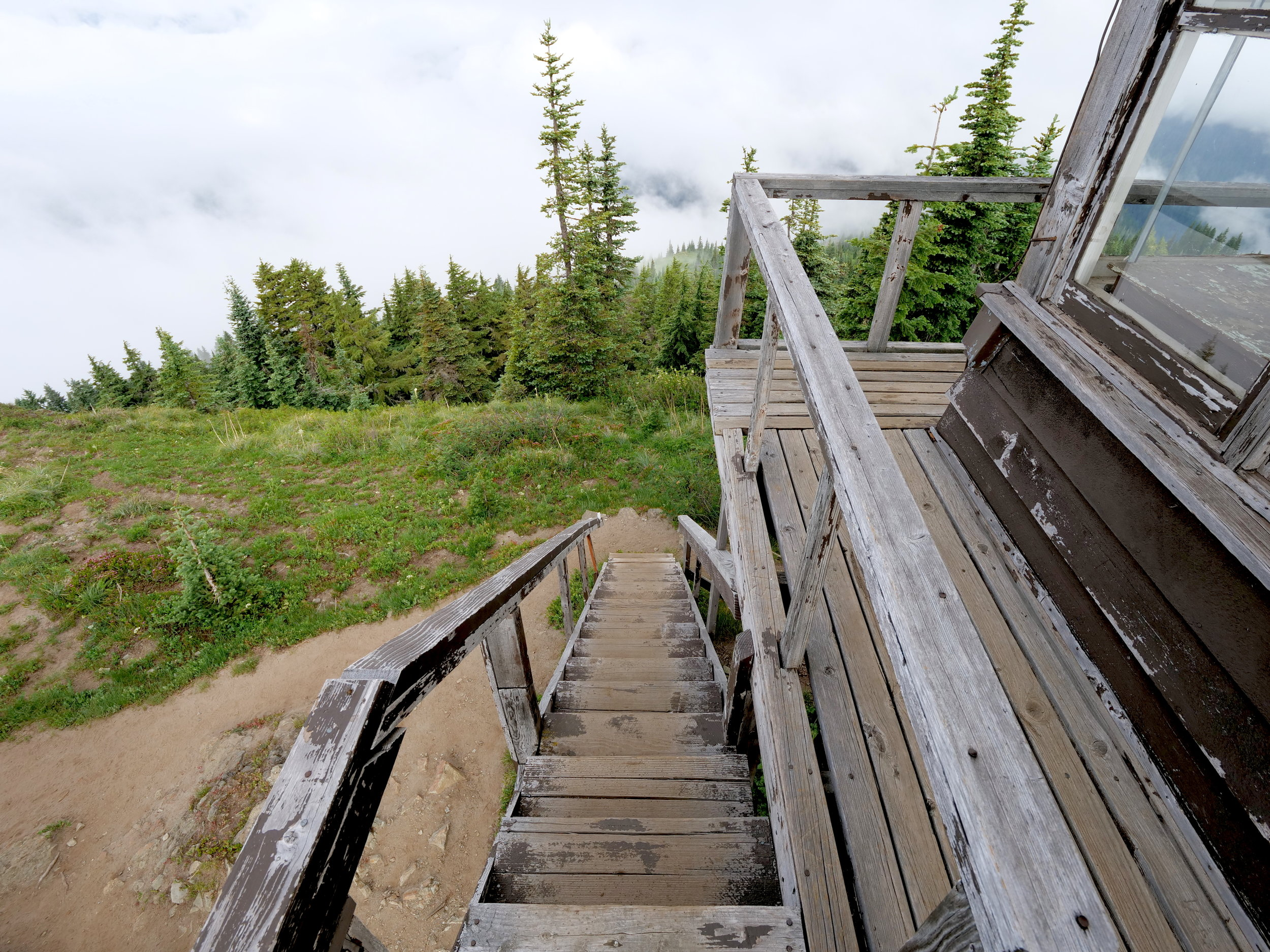 Creaky stairs lead to the weathered cat walk around the Shriner Peak lookout