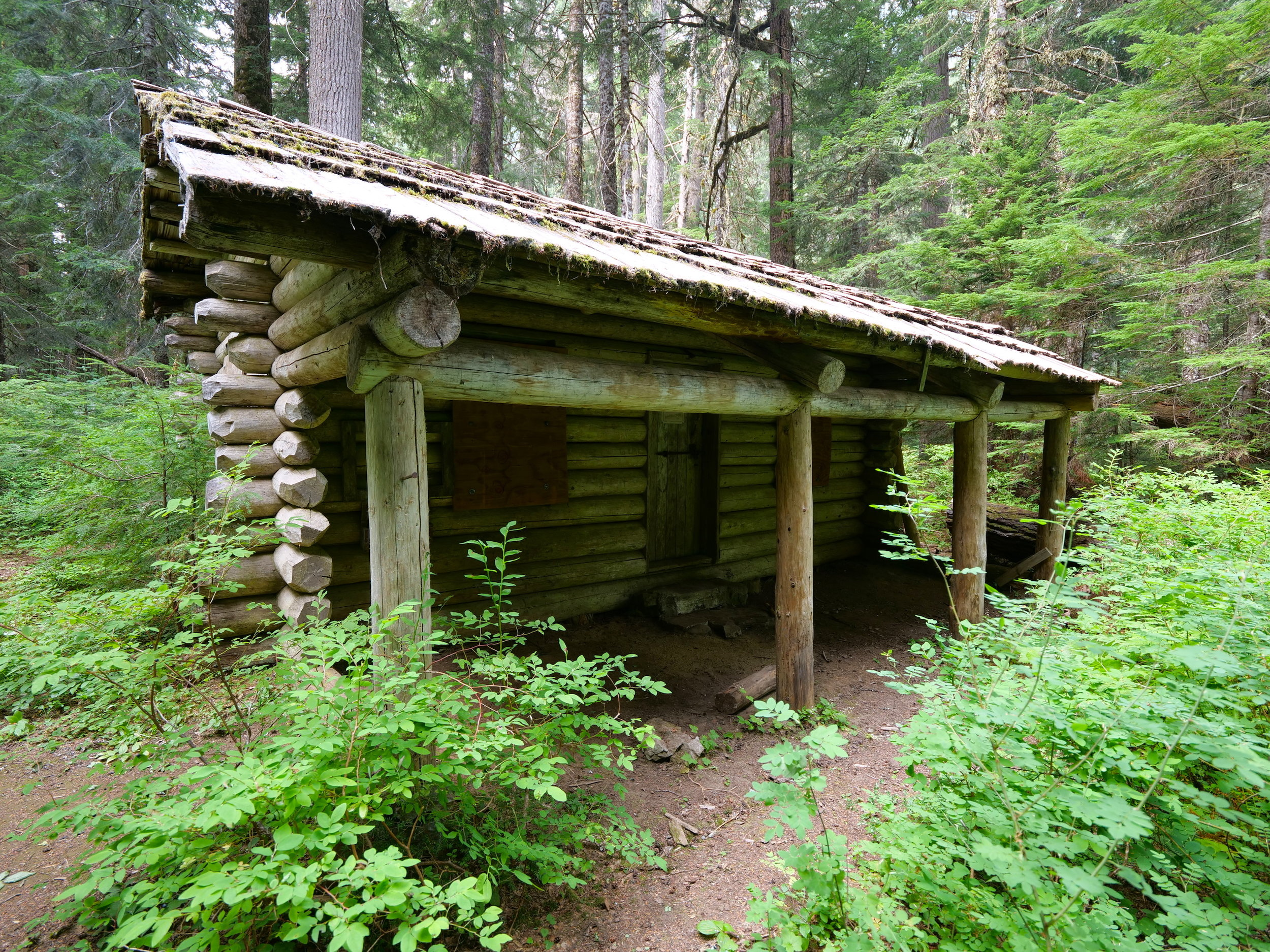Shuttered patrol cabin on the northern park border, Huckleberry Creek Trail