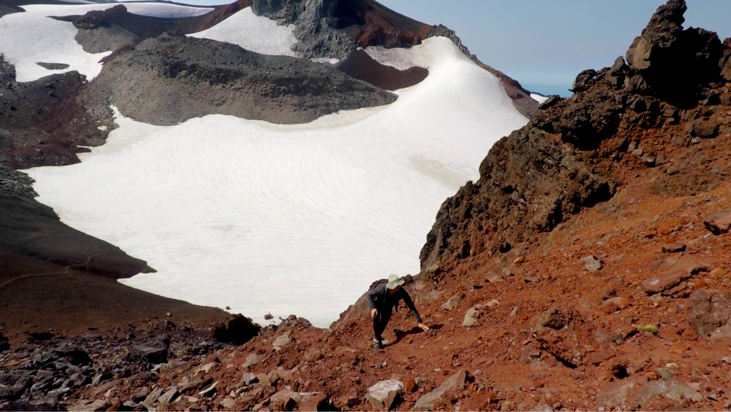 Climbing the lower slopes of Echo Rock, Flett glacier in the background