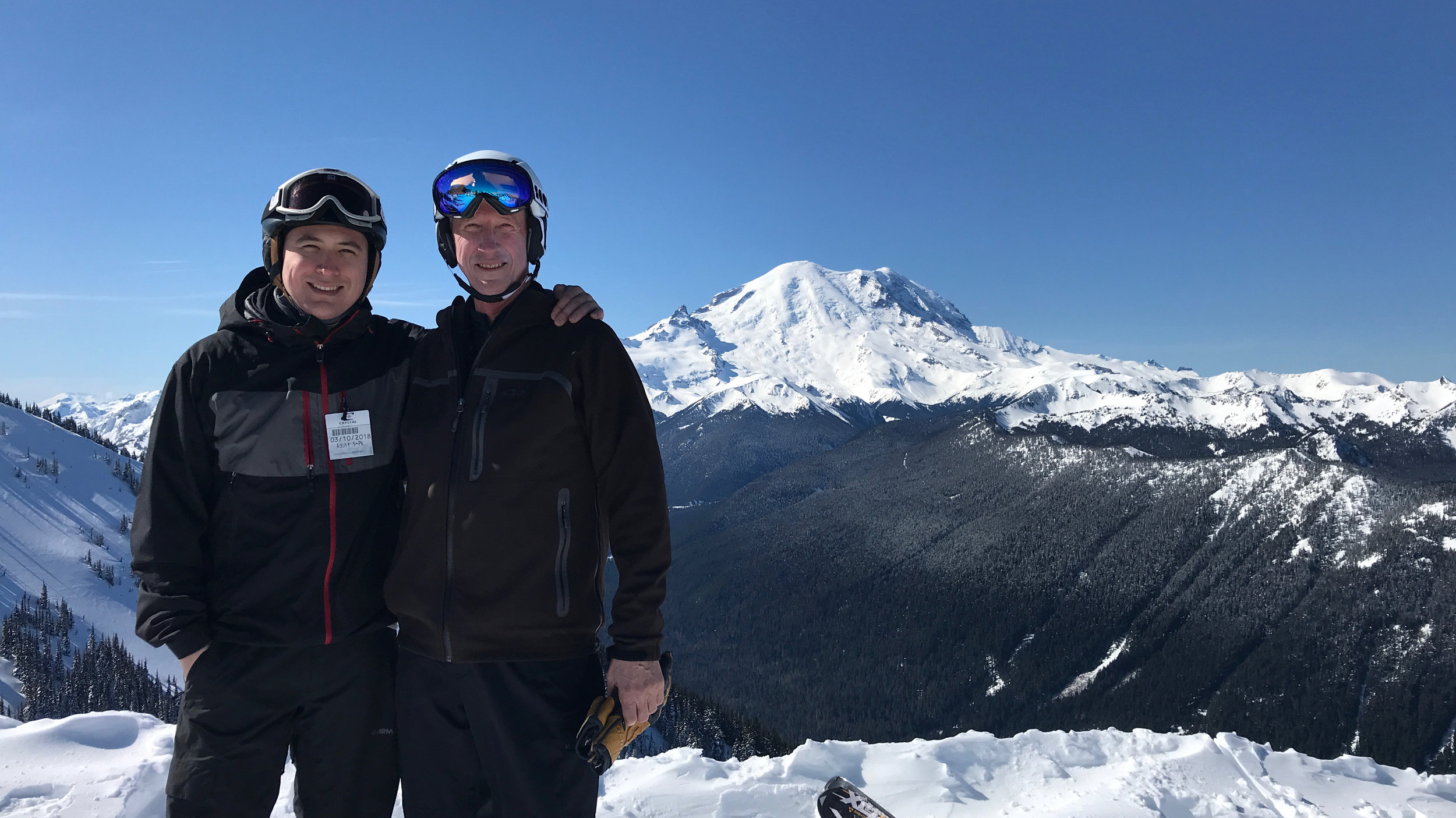 With my son during Crystal ski day; the view that was missing during the summer trip