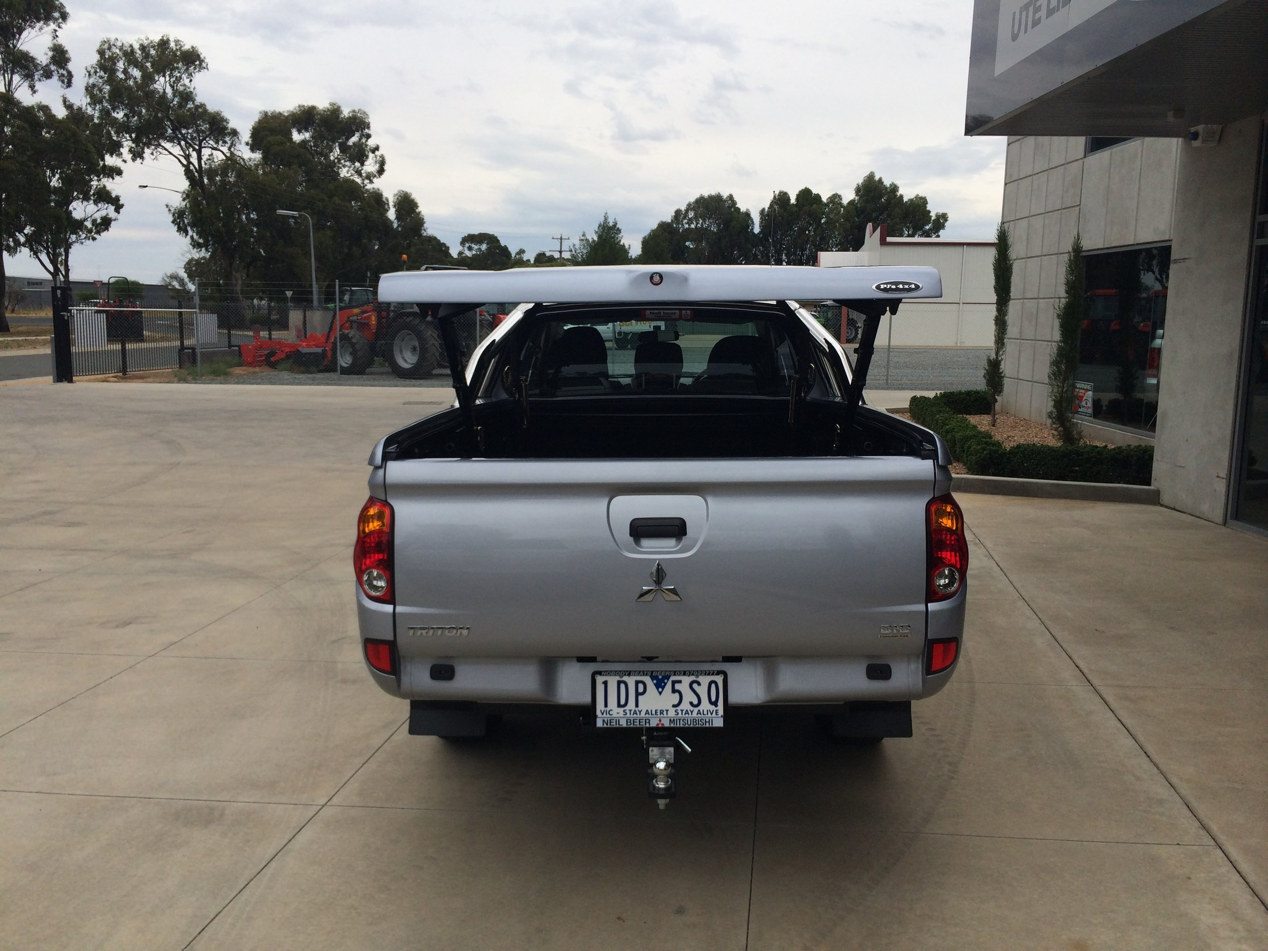 Mitsubishi Triton Top Up Lid with Styling Bars Silver 7.JPG