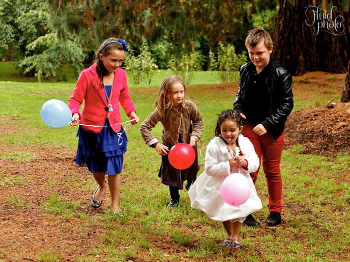 Children at a rainy wedding photo