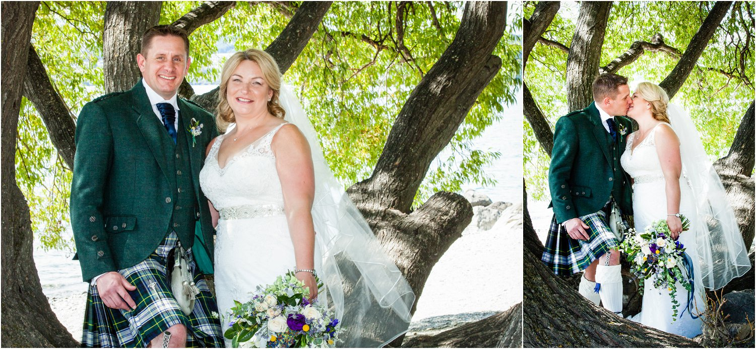 Bride and groom stand under tree at Waterfall Creek in Wanaka