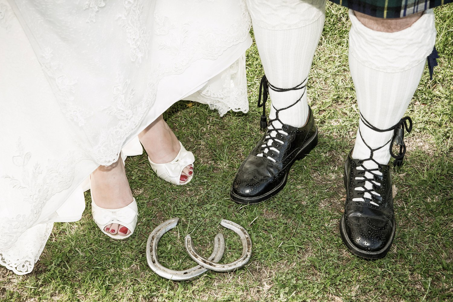 Detail portrait of wedding shoes and horse shoes by Wanaka wedding photographer Fluidphoto
