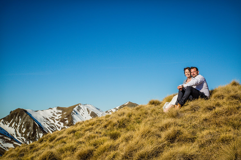 19-bride-groom-sitting-outdoors.jpg