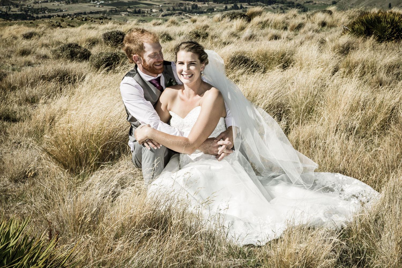 newlyweds-cuddle-in-tussock.jpg