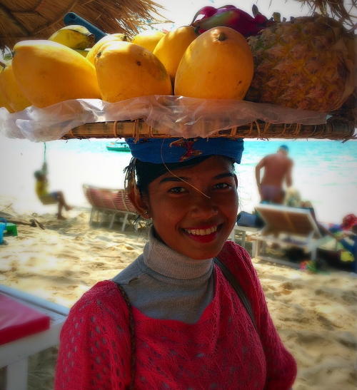 She walks the beach every day selling fruit. This is her job at 16 years of age and will likely be her job for the rest of her life.