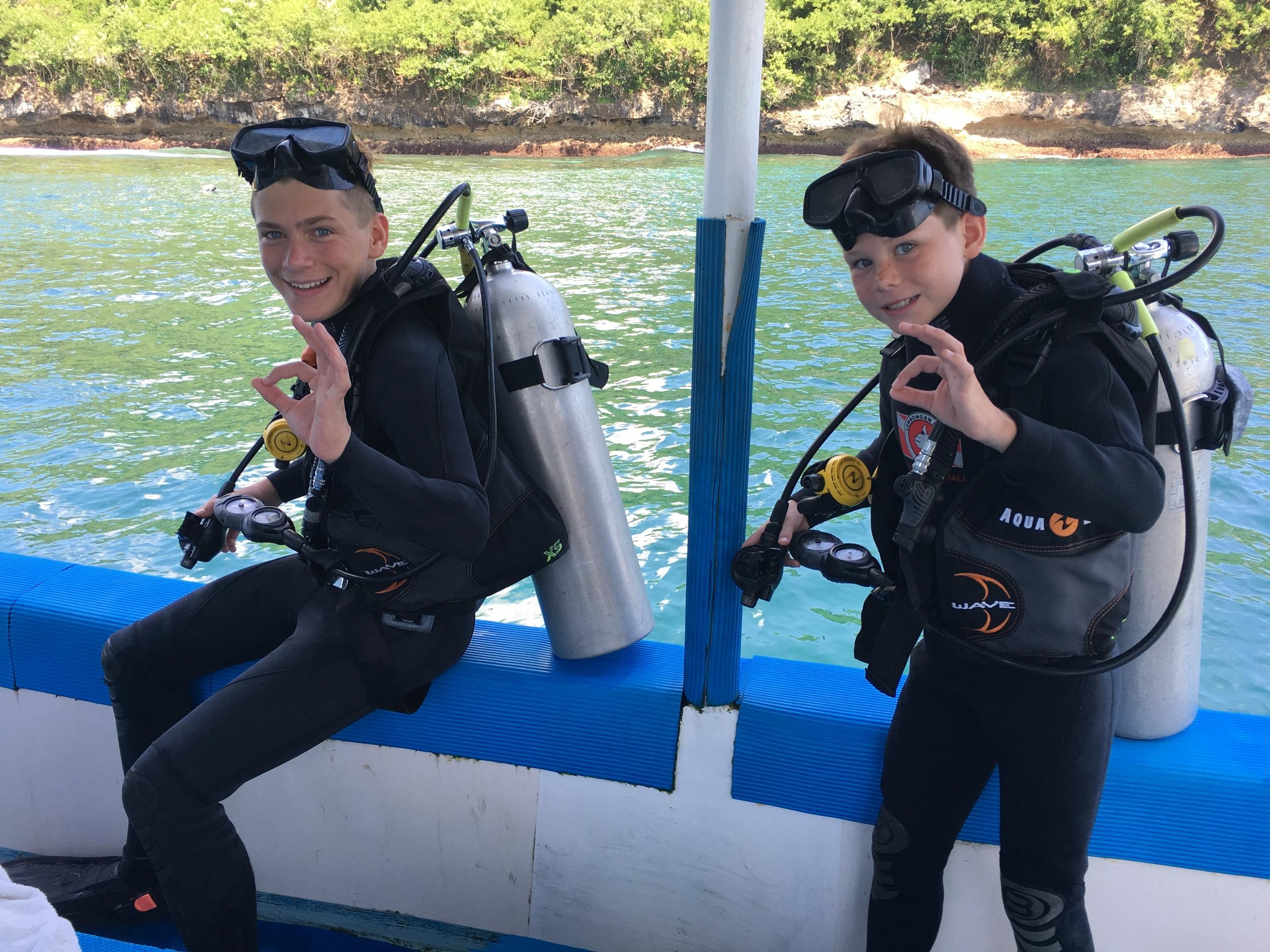 Brave scuba diving kids with cool parents