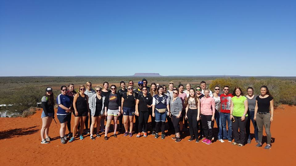 Us proudly taking a group photo in front of what we thought was Uluru... Photo Credit: Mark Davies