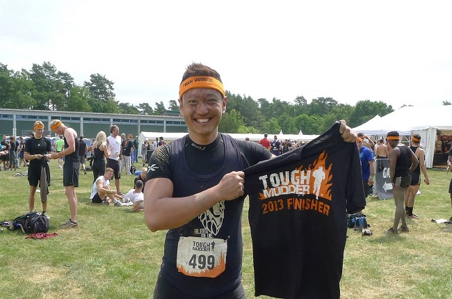 Kelvyn proudly showing off his finisher T-shirt at the Tough Mudder Germany 2013