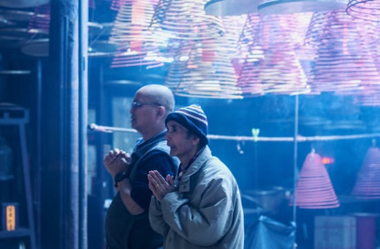 Two men praying at the Tin Hau Temple in Yau Ma Tei.