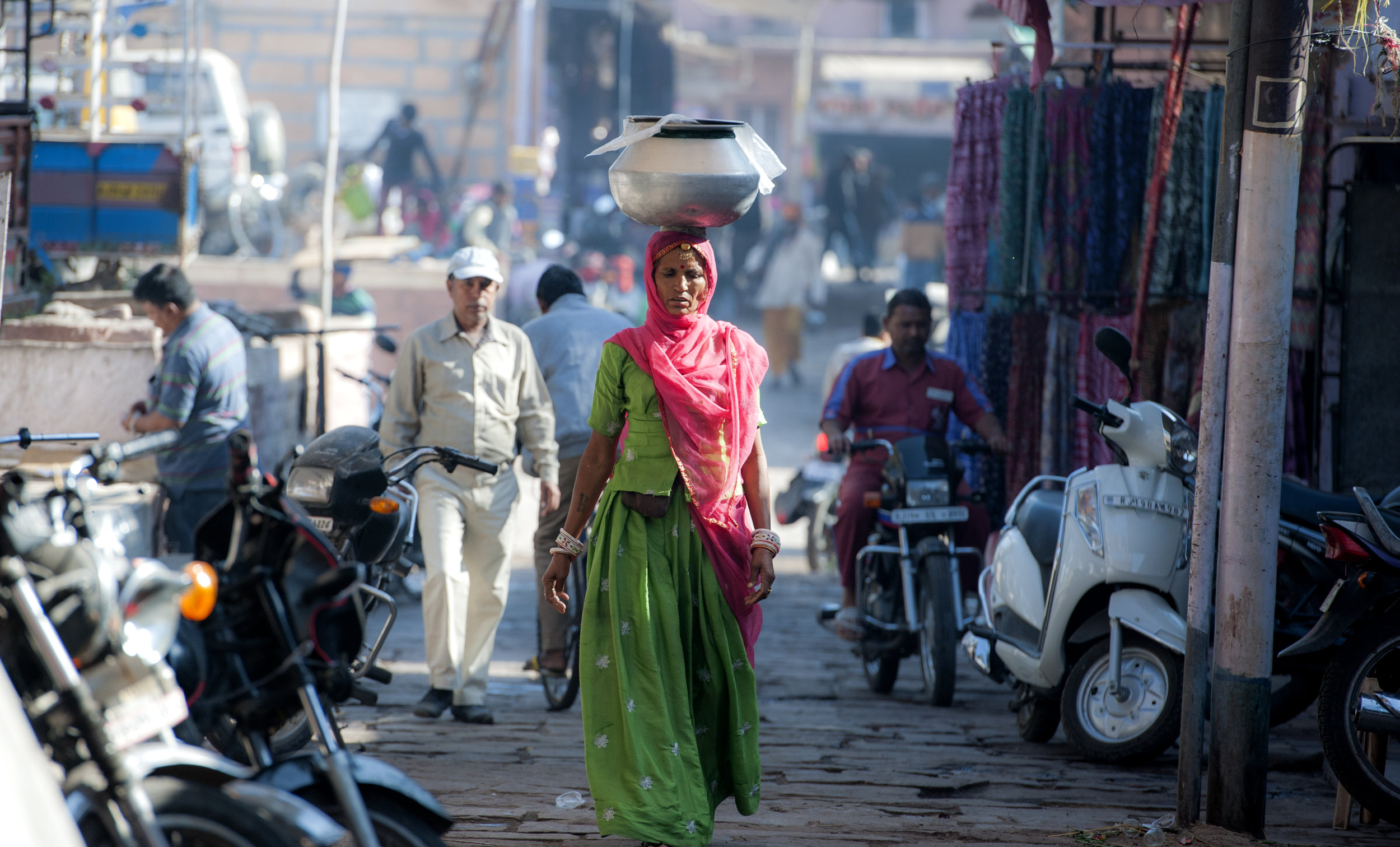 On a street of the dusty market in Jodhpur, India, she walked toward me with such a beautiful elegance.