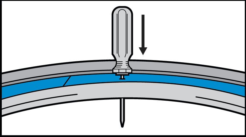 Step 3 - Use a Phillips Screwdriver (the diameter of the valve hole) to create space for your valve in the Rim Tape.