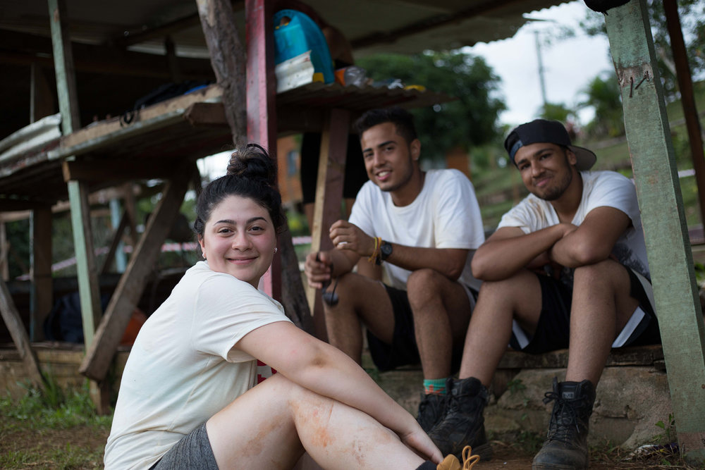 Maria, Juan and Shez (left to right) taking a break from building