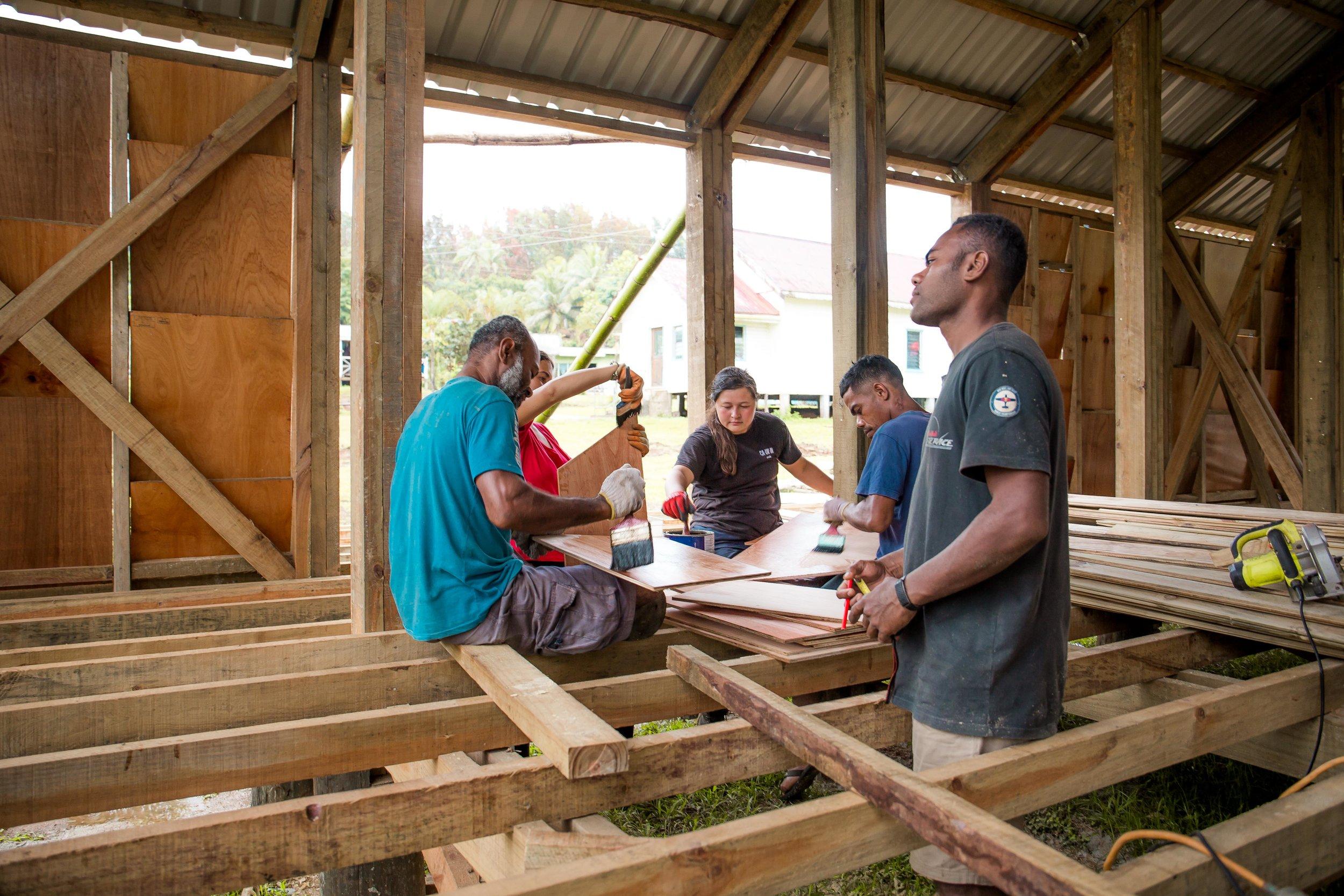 'Crafternoon' on the Savudrodro Community Hall building site - varnishing the doors