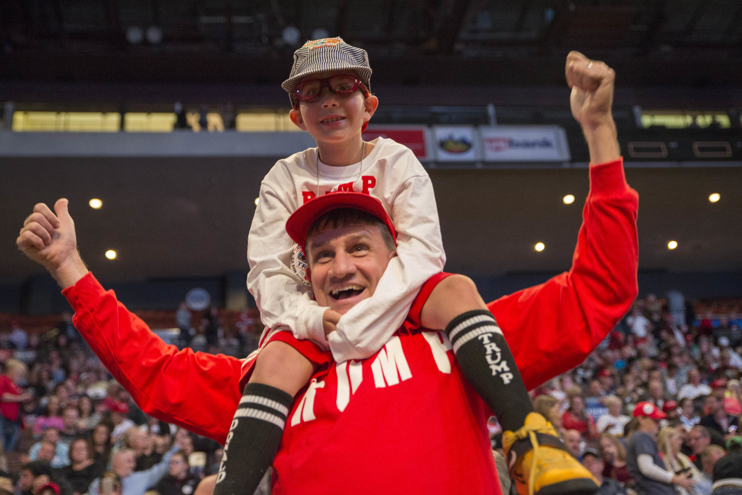 Fred and his son, Charlie Caldwell express their excitement at a rally for Republican nominee Donald Trump at US Bank Arena in Cincinnati, Ohio on October 13, 2016.