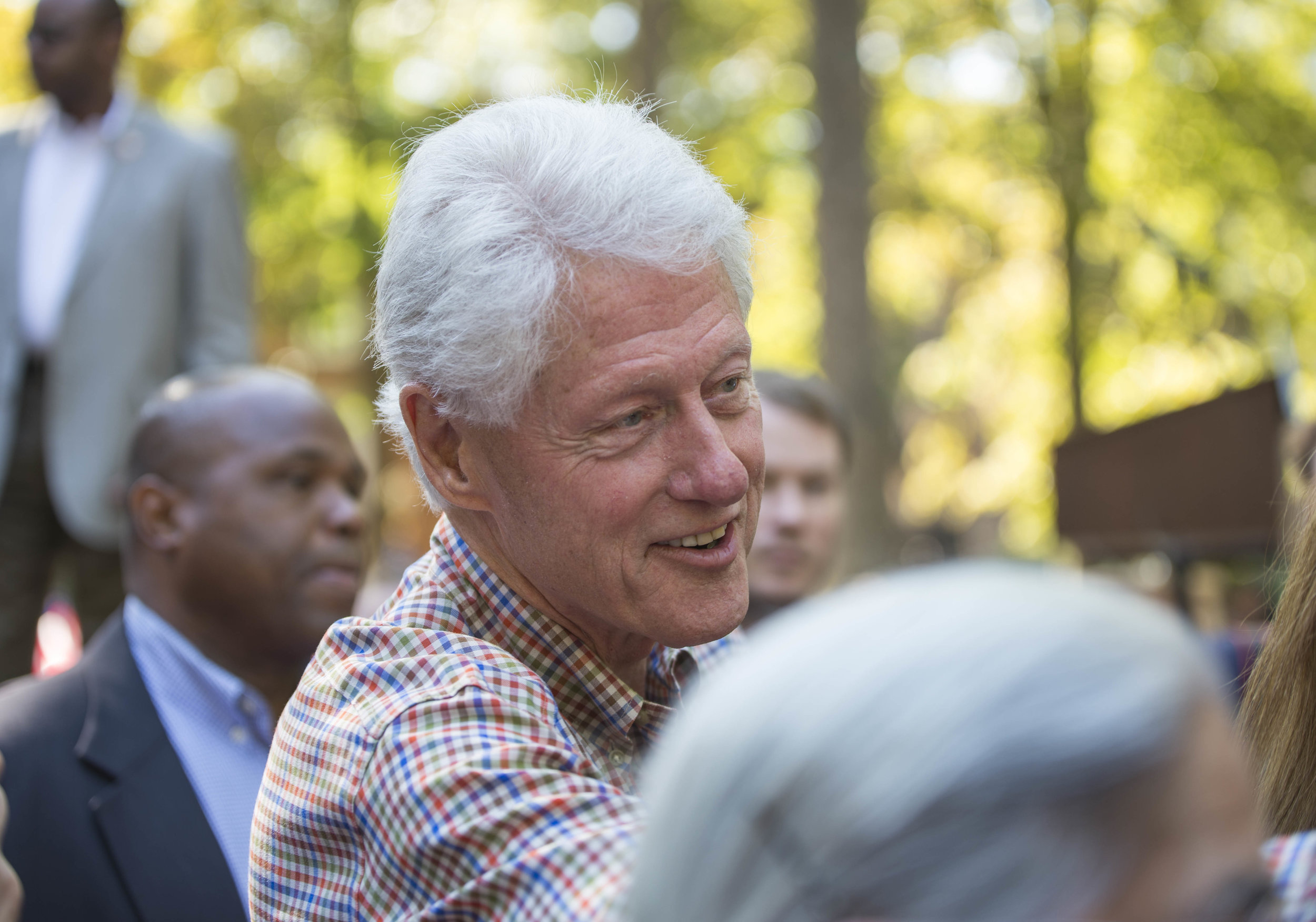 Former President Bill Clinton shaking hands with supporters after a campaign stop for his wife, Democratic nominee for president, Hillary Clinton in Athens, Ohio on October 4, 2016.