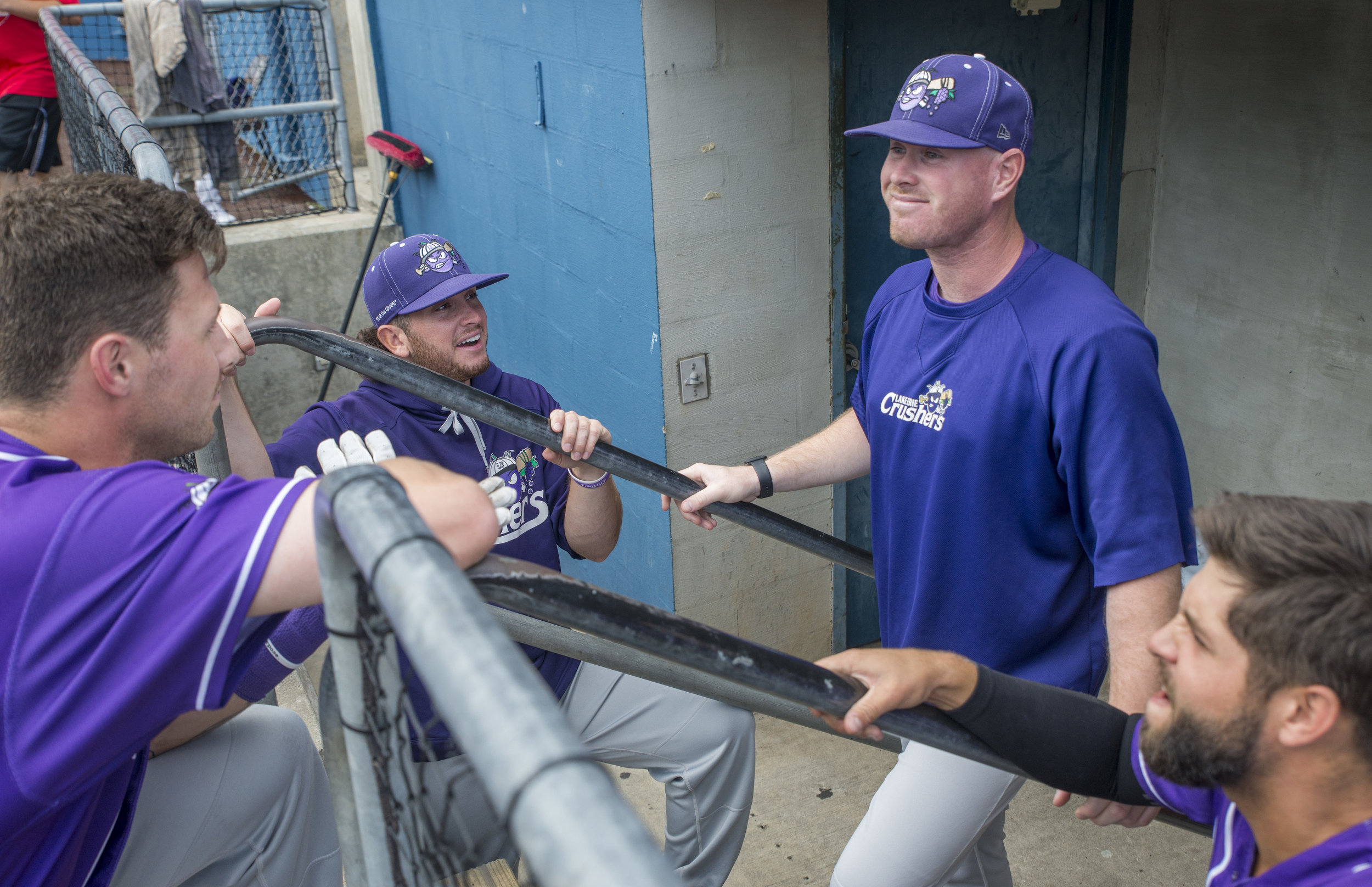 Telling jokes in the dugout.