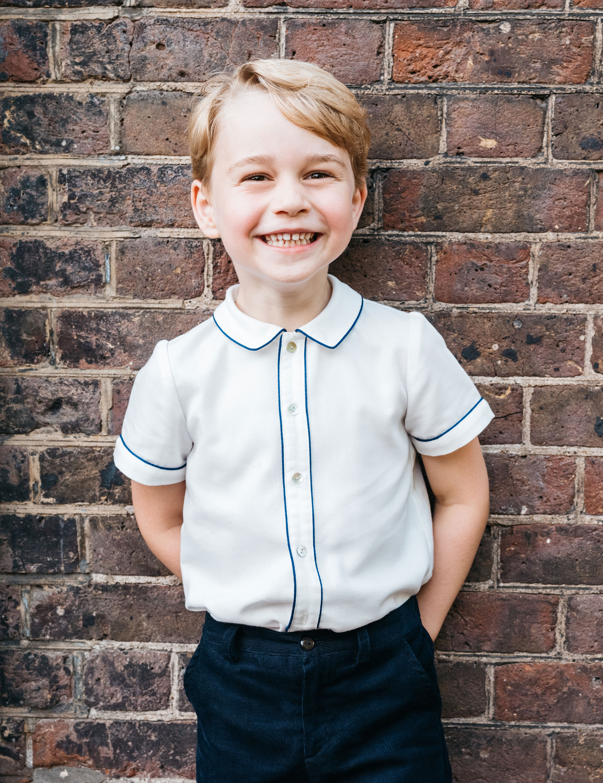 The ocean-loving photographer who took Prince Louis' iconic candid christening photo is also the man behind the lens for the official photographs to mark His Royal Highness's Prince George fifth birthday on July 22nd 2018.