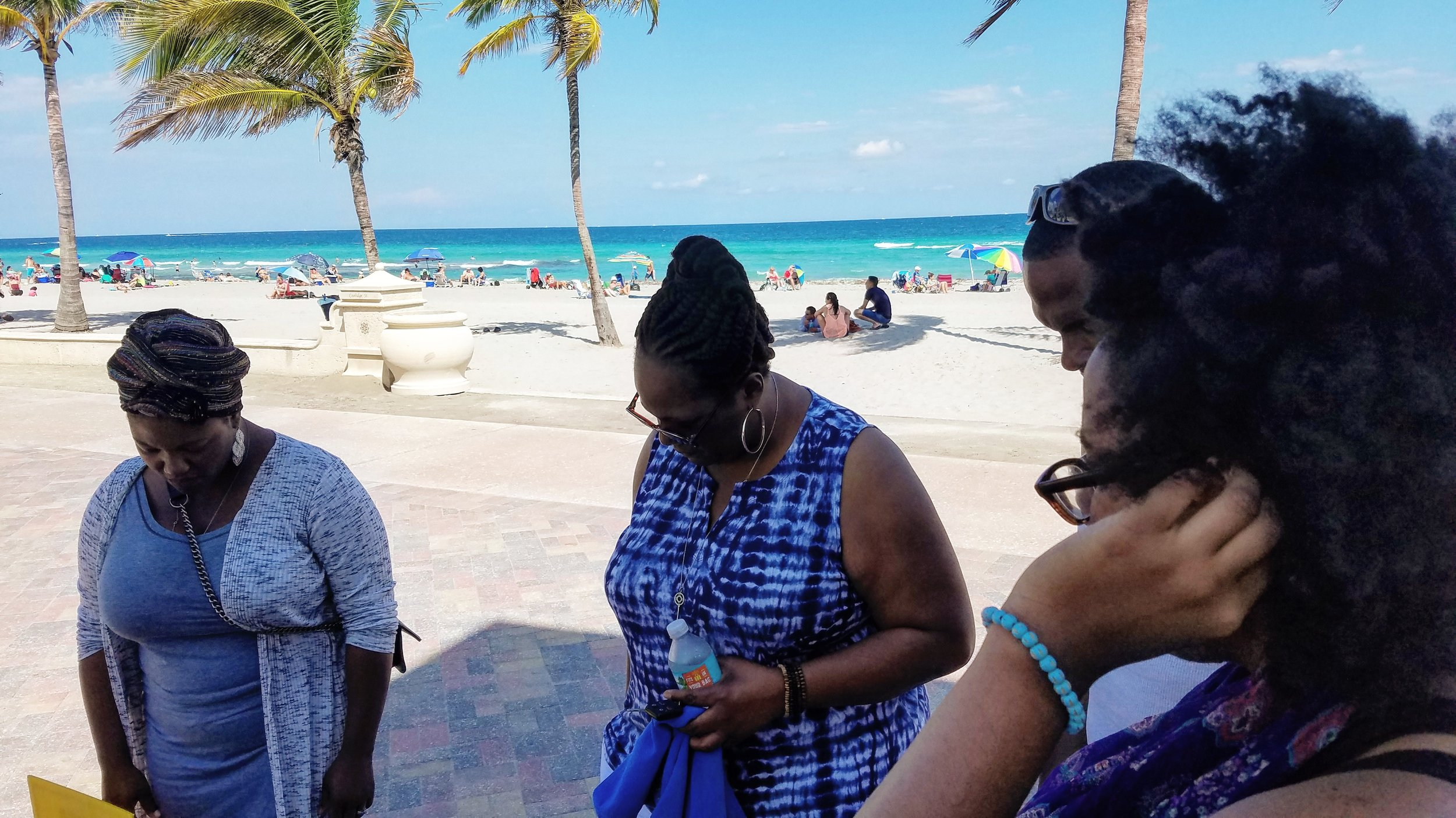 Praying at the end of our beach outreach.