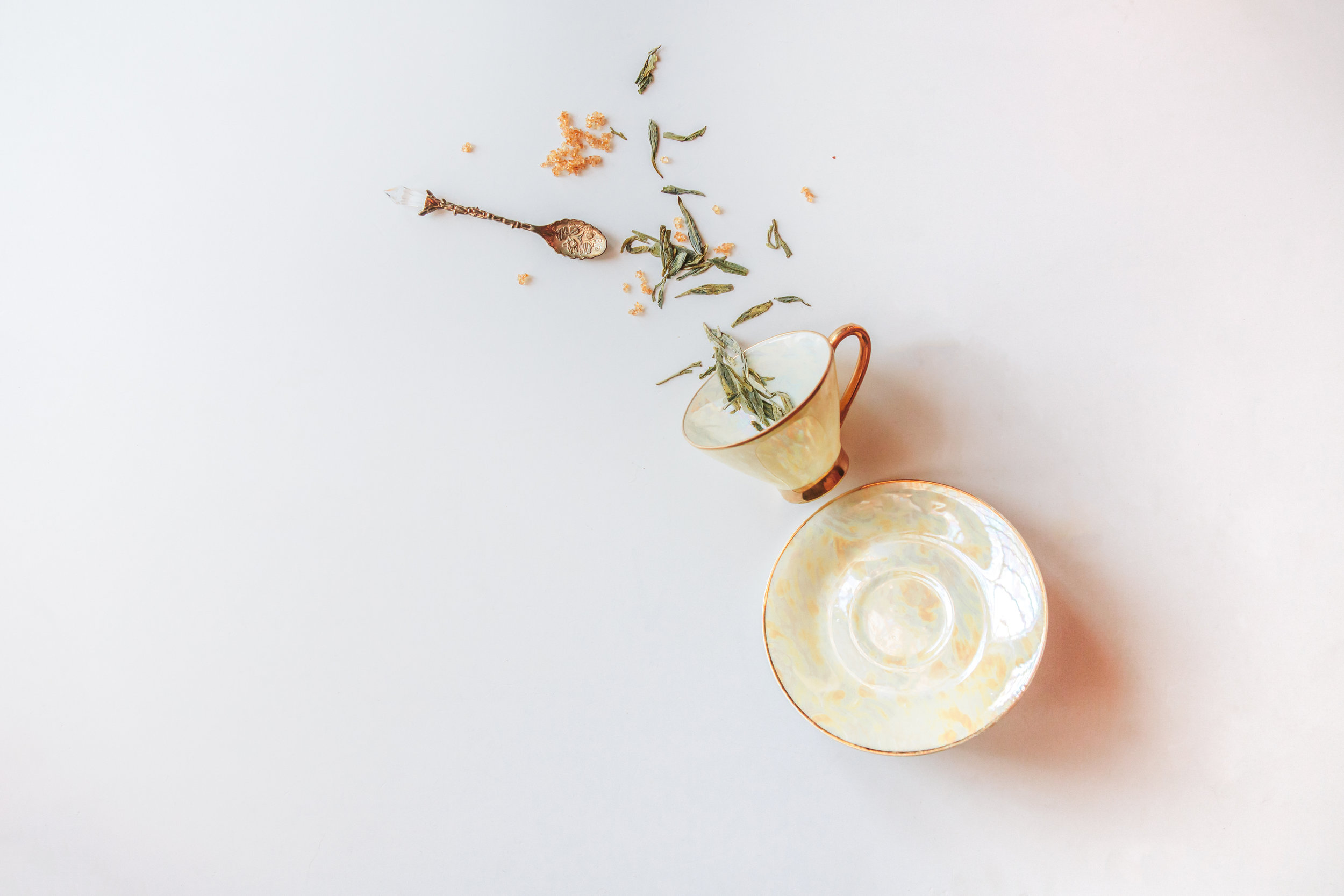 Delicately shaded pale yellow and gold tea cup, passed down from Amreen's grandmother in a set of twos to various members of the family.