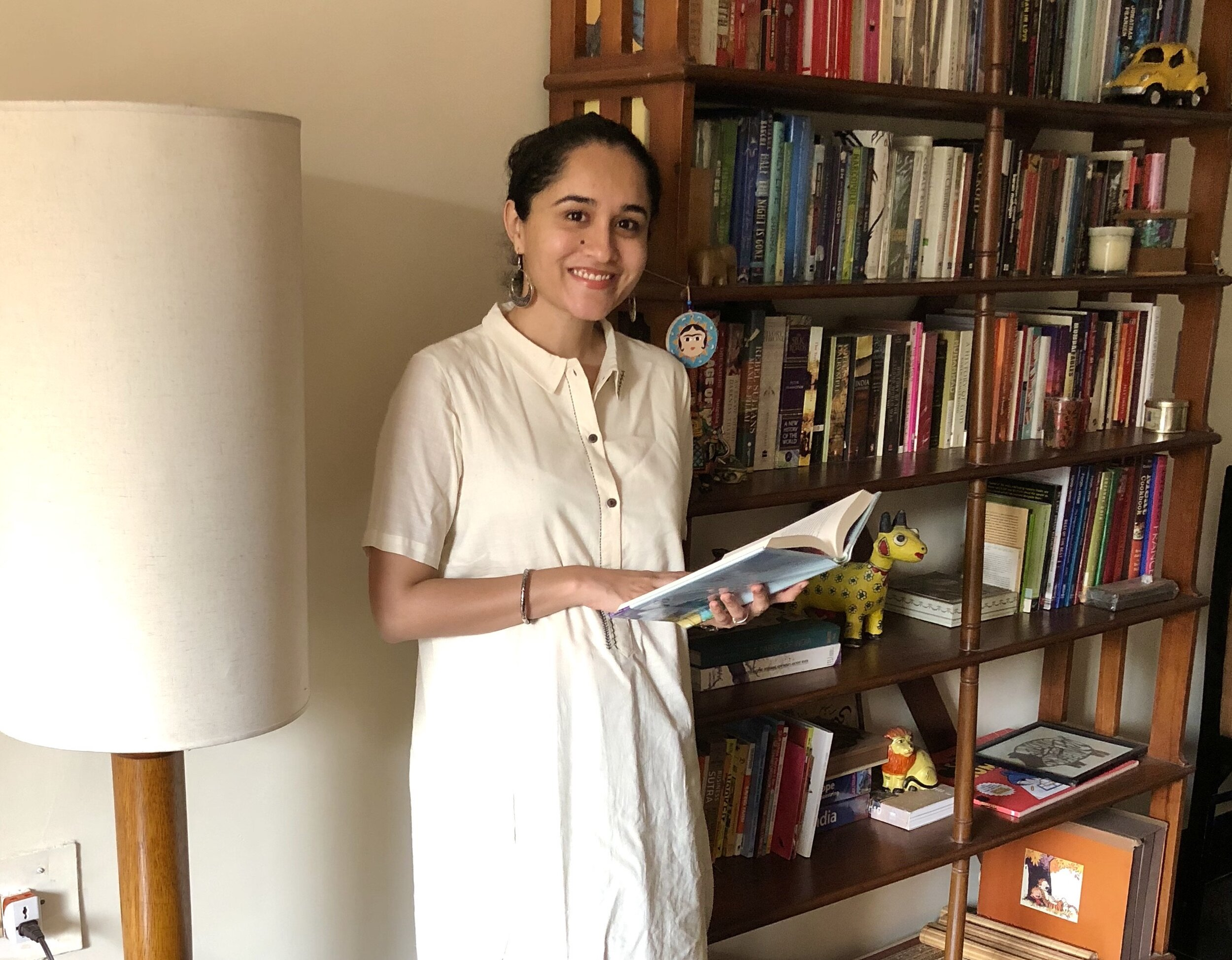 The author with her personal book collection.