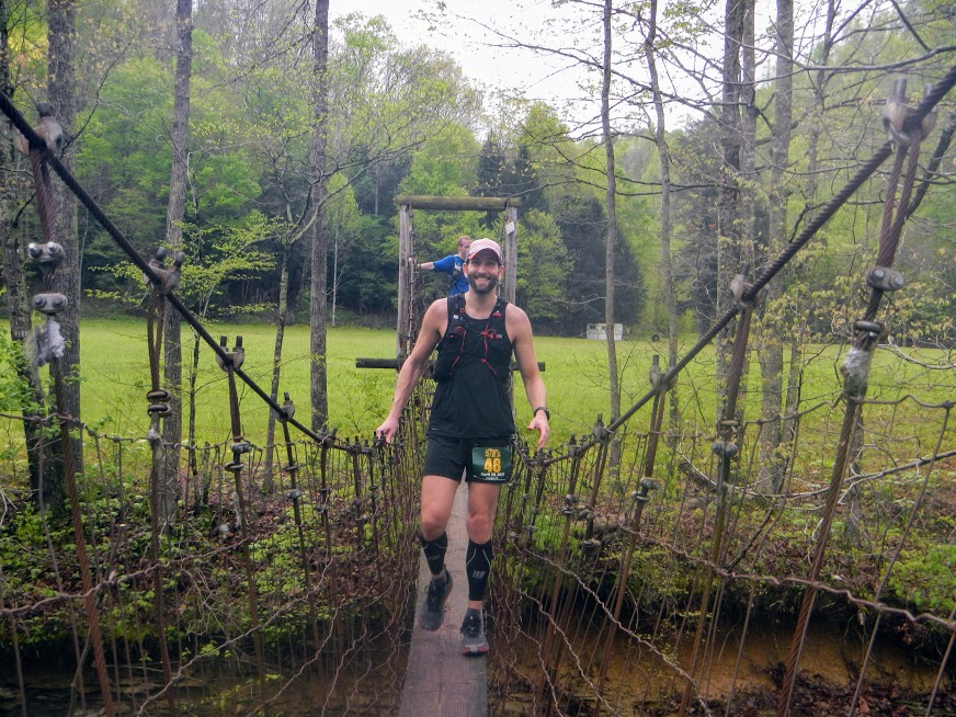 Runners make their way across the swinging bridge. Still smiling!