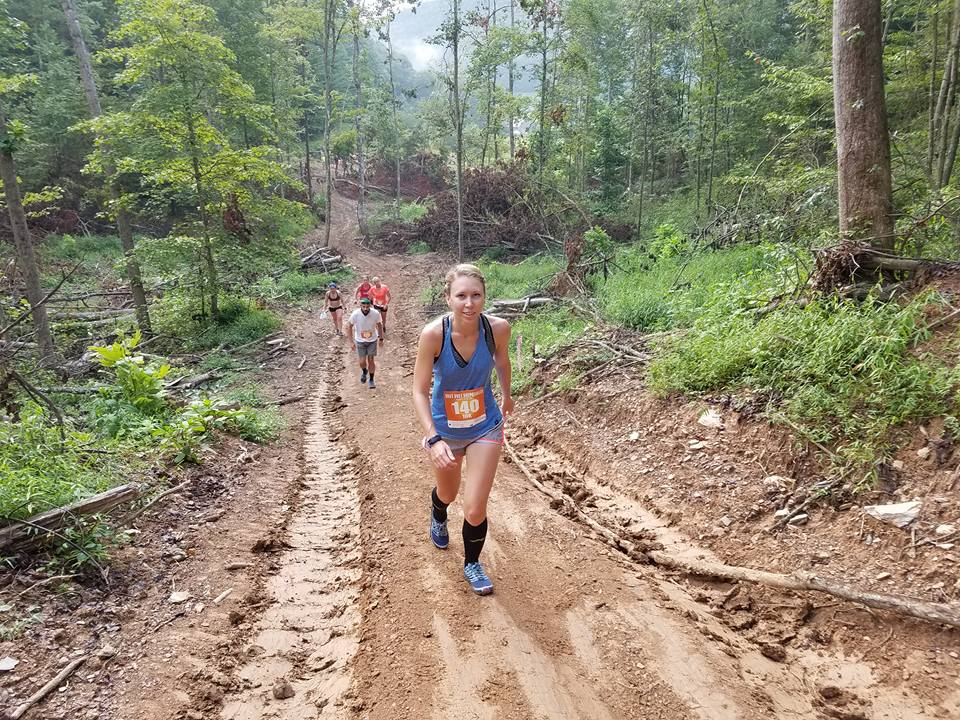 Runners beginning the second big climb of the 10K. Slick mud and straight up! Photo by: Al Fryman.