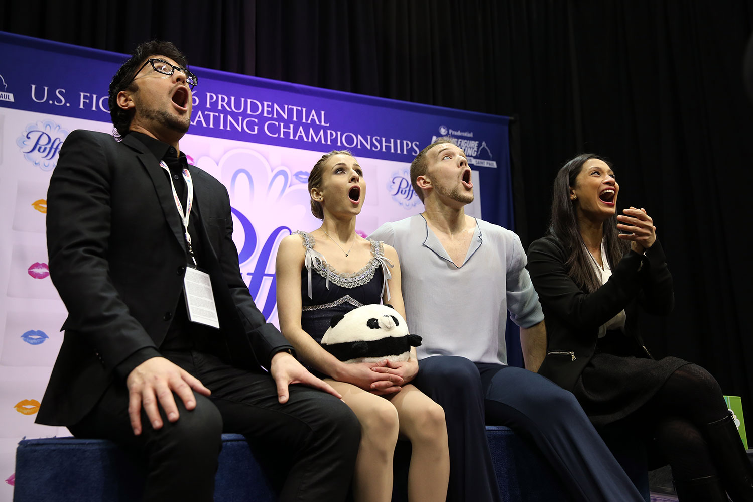 Skaters Tarah Kayne (with stuffed animal) and Daniel O'Shea and their coaches Jim Peterson (far left) and Amanda Evora,react with shock and delight over their personal-best score in the pairs free skate. (U.S. Figure Skating / Jay Adeff)
