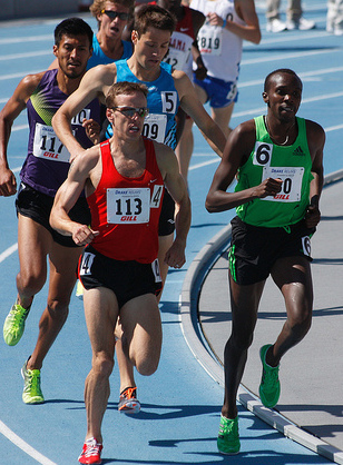 Alan Webb (red jersey) in the mile at the 2011 Drake Relays, where he finished fourth in the mile in 3 minutes, 58. 77 seconds
