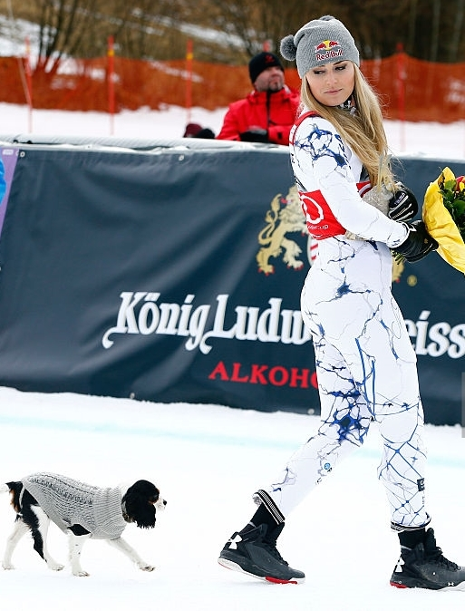 Lindsey Vonn's dog, Lucy, accompanies her after the medal ceremony for a Feb. 7 Super-G at Garmisch, Germany. (Christophe Pallot / Agence Zoom / Getty Images)