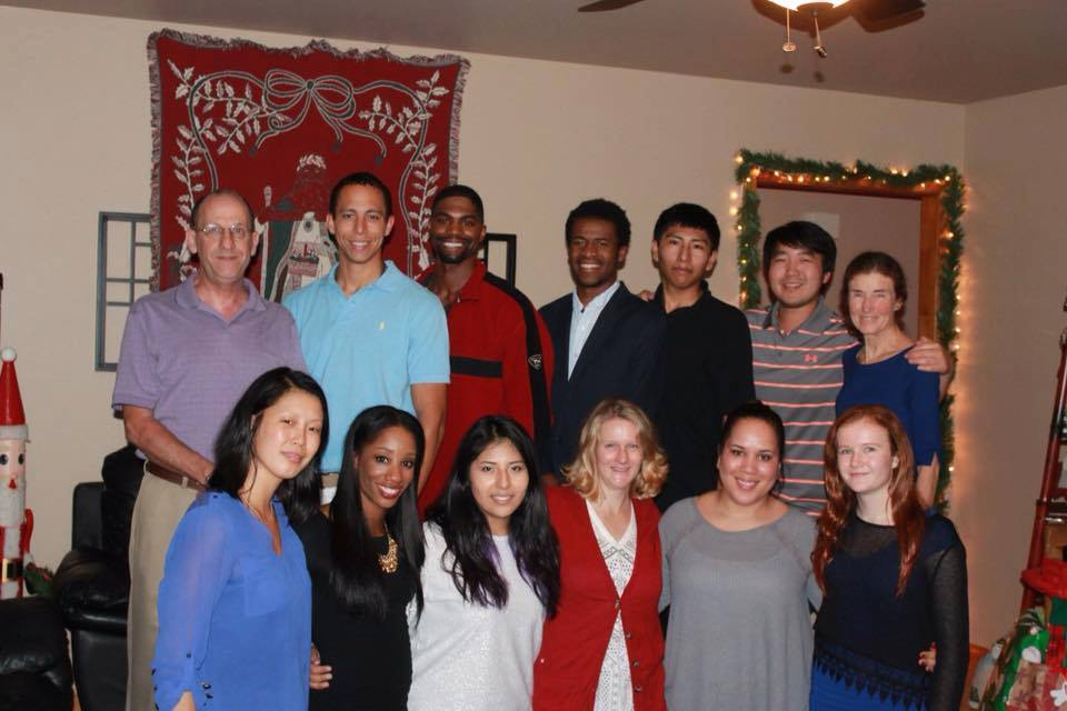 The Harrison family, which includes nine adoptees (including Keni, front row, 2d from left) among their 11 children, at Christmas 2015.  (Photo courtesy Harrison family.)