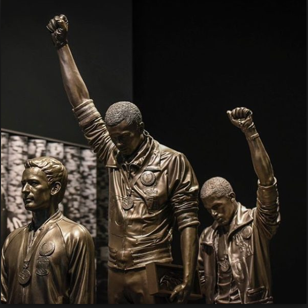 The sculpture at the new National Museum of African American History and Culture portraying the now iconic 1968 Olympic podium protest by Tommie Smith (center) and John Carlos (right).